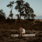 Couple snuggling together outside for a Connection Session in Michigan with Lume Photography