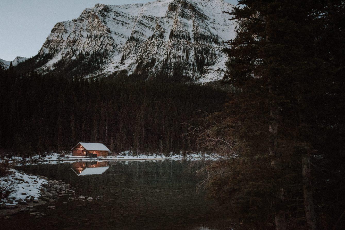 log cabin at Lake Louise in Banff at daybreak in winter
