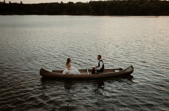 Bride and groom in canoe in Gaylord Michigan