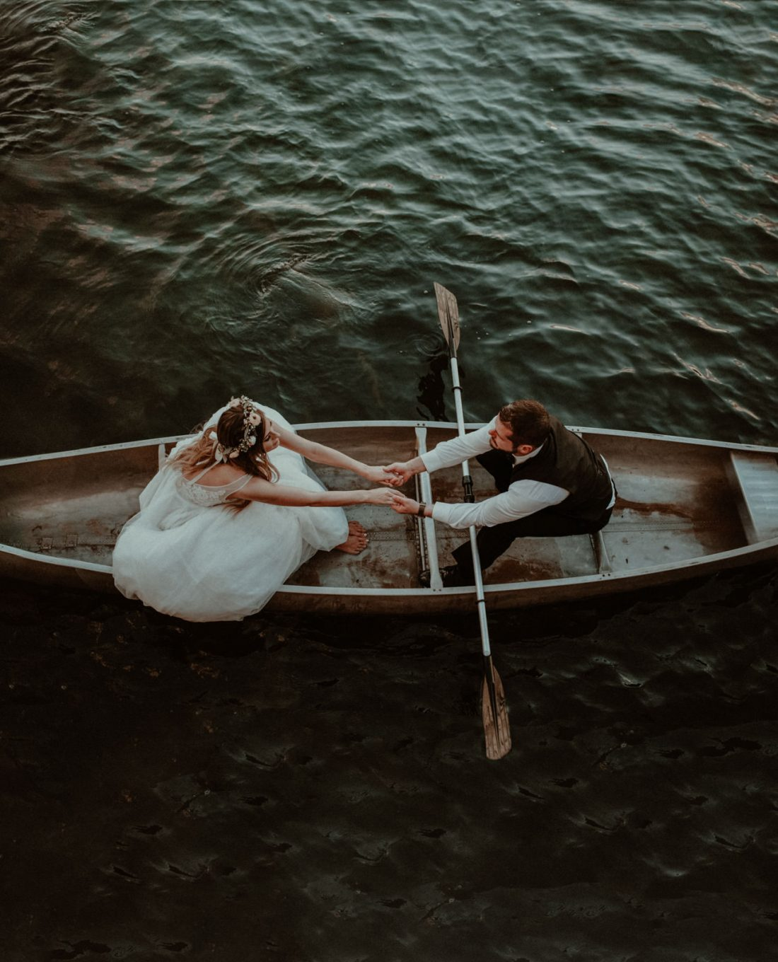 Overhead photo of bride and groom in a canoe in Michigan