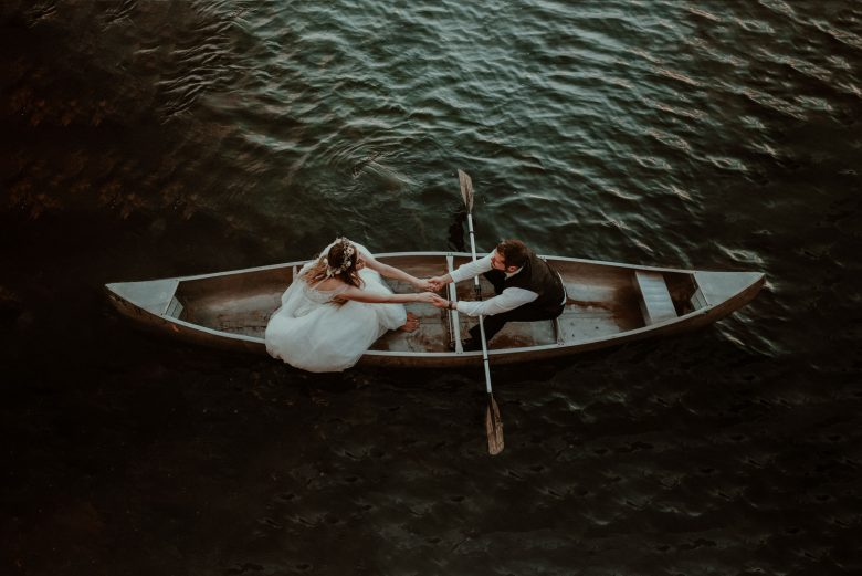 Michigan wedding in Gaylord- couple in a canoe.