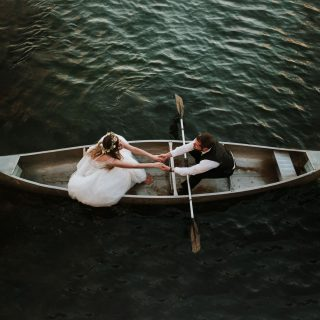 Bride and groom in a canoe in Graying, Michigan