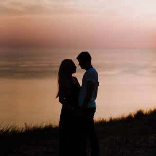 Silhouette of a couple at sunset for their engagement photos