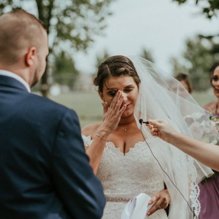 Bride crying during vows at wedding