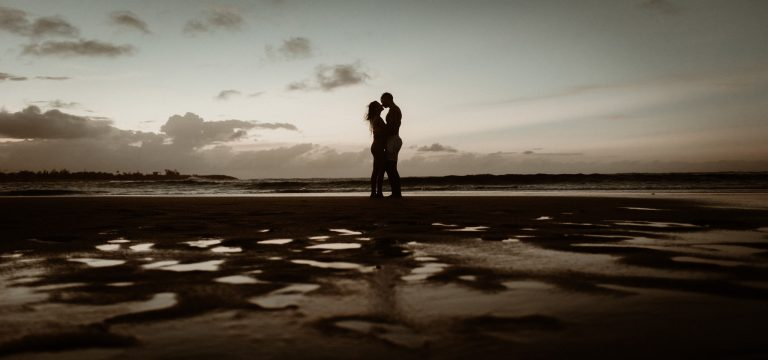 Silhouette of couple on beach in Puerto Rico