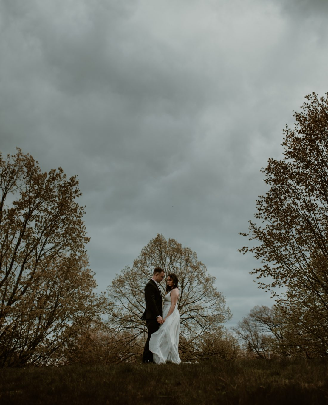 Couple at wedding in the trees
