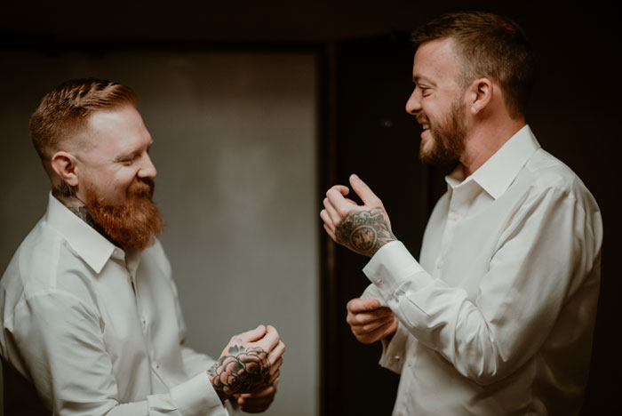 Two grooms getting ready in Grand Rapids Michigan wedding