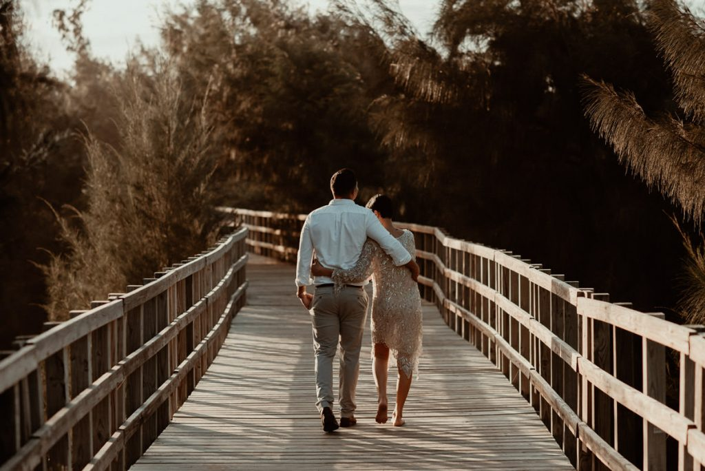 Couple walking down a boardwalk in Puerto Rico