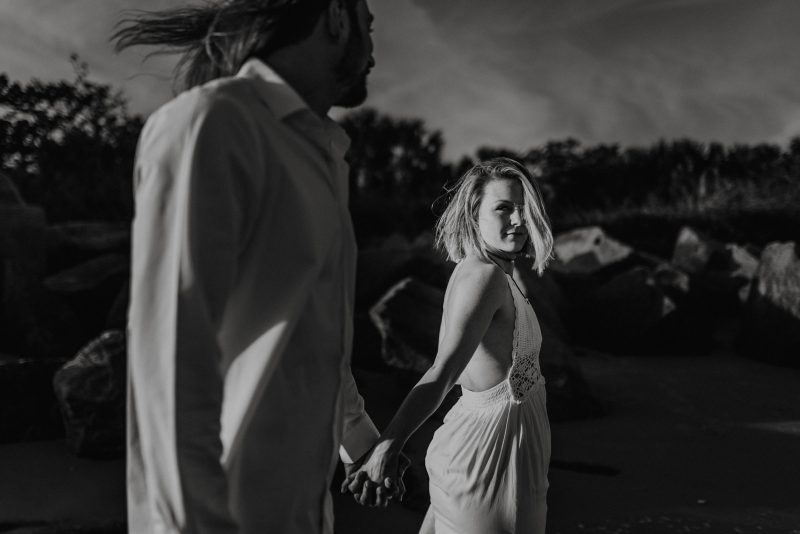 Couple walking hand in hand on Florida beach at their elopement