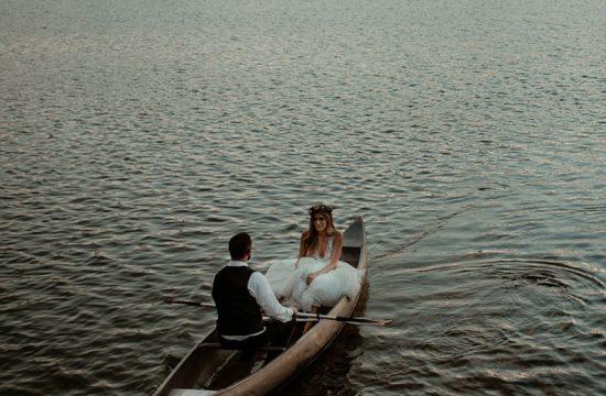 Bride and groom rowing canoe