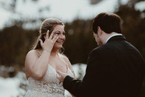 Bride crying happy tears at elopement in Colorado.
