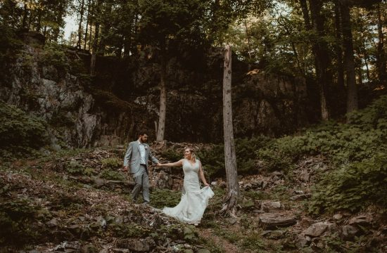 Bride and groom hiking at Carp River Gardens in the Upper Peninsula