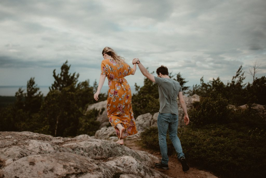 Adventurous couples portraits on Hogback Mountain in Marquette, Michigan.