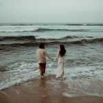 Elopement couple walking into the sea together