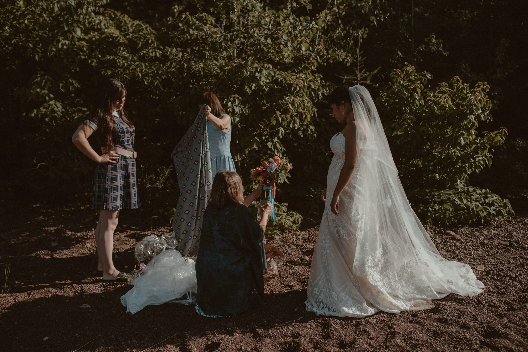 Mother offering the bride her bouquet