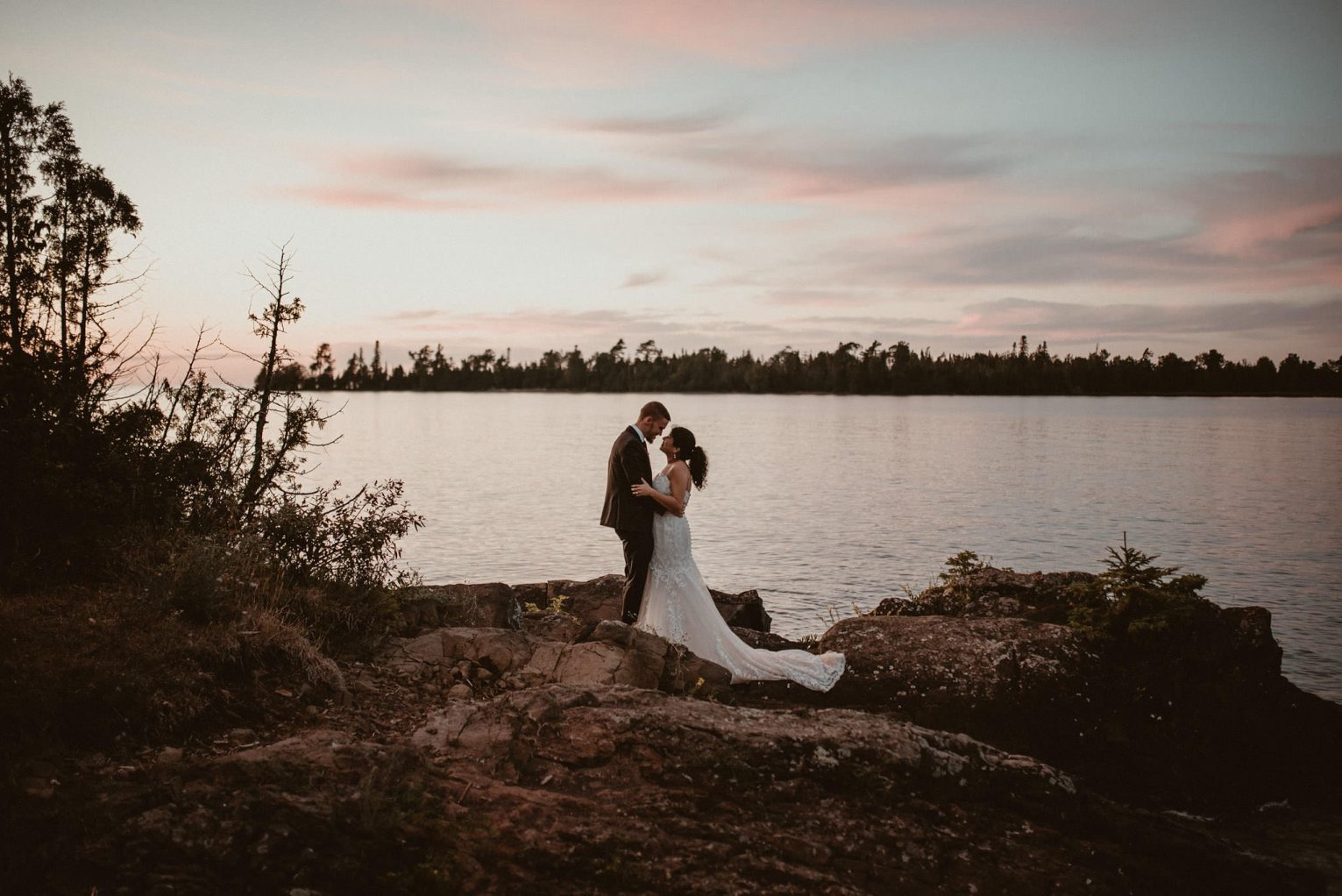 Bride and groom portraits on Lake Superior at sunset