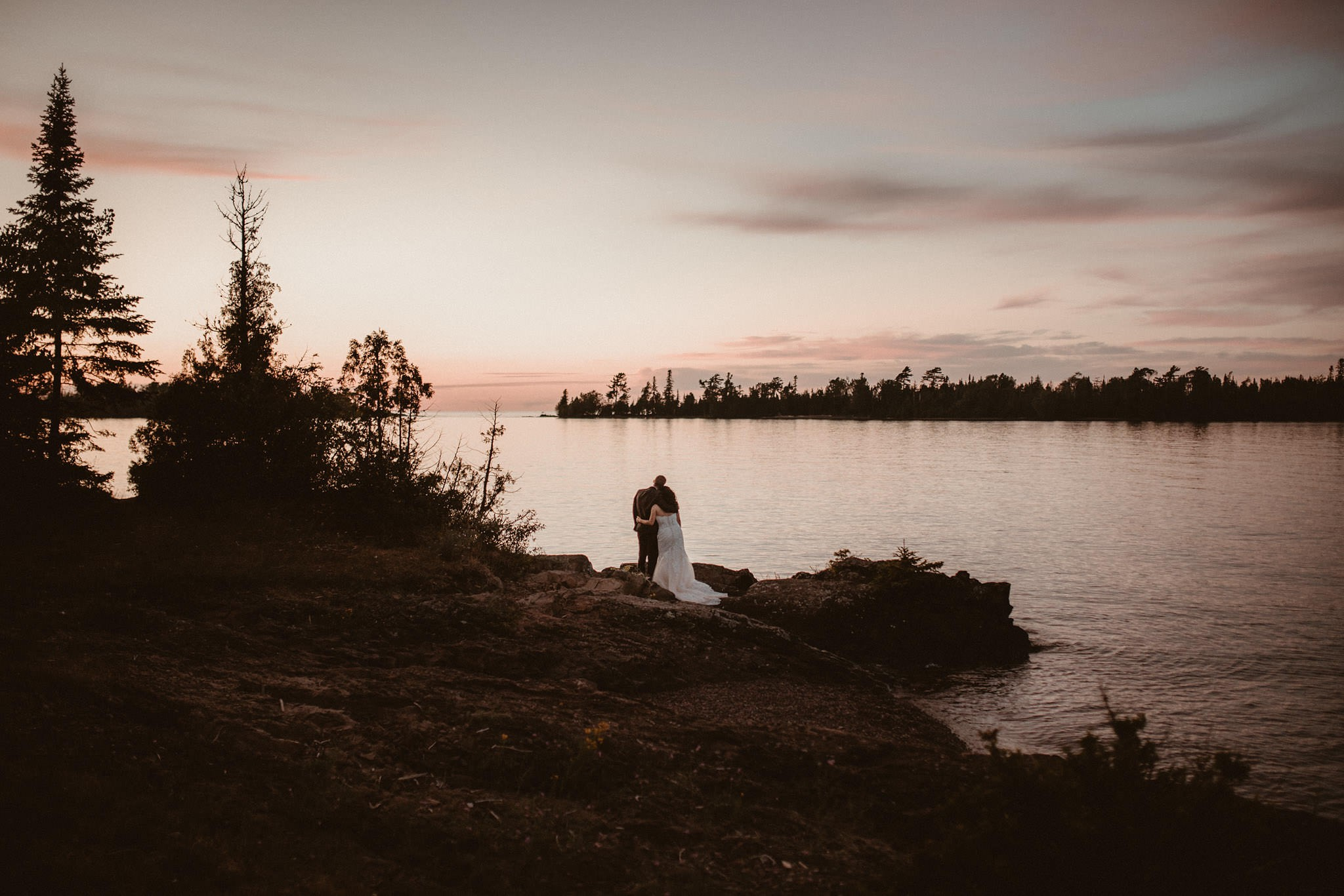 Bride and groom portraits in Copper Harbor, Michigan at sunset