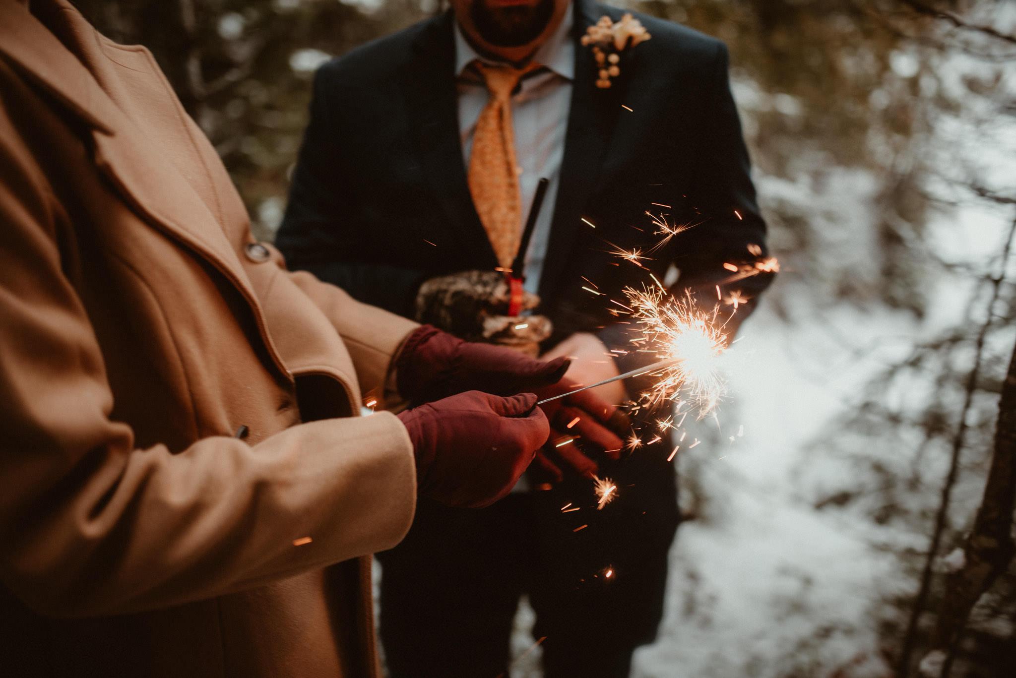 Sparkler photos at a winter elopement in Michigan