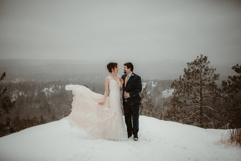 Elopement on Sugarloaf Mountain in Michigan in the snow