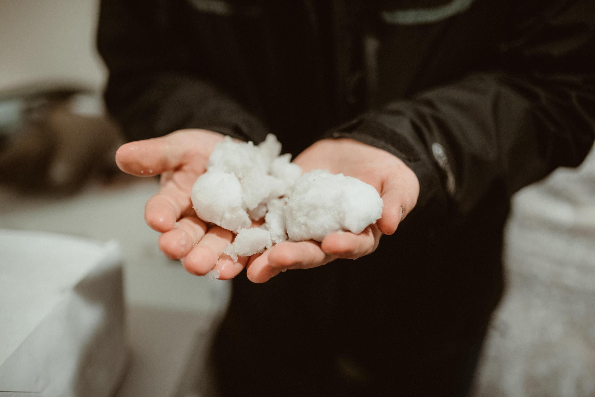 Groom holding snowballs