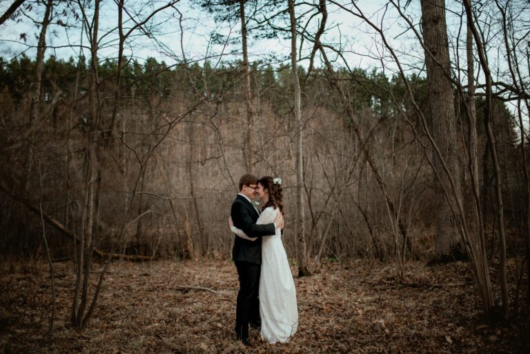 Michigan elopement portrait of bride and groom in the forest